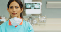 Lady dental assistant in scrubs and mask